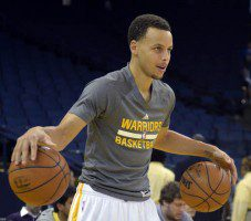 Golden State Warriors' Stephen Curry (30) warms up before his team takes on the Atlanta Hawks at Oracle Arena in Oakland, Calif., on Wednesday, March 18, 2015. (Susan Tripp Pollard/Bay Area News Group)